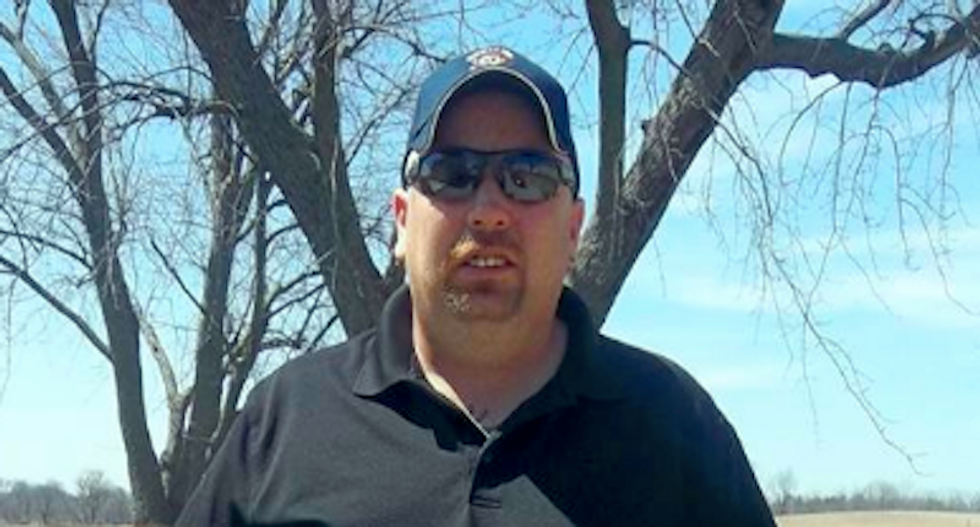'Gun toten redneck' Ohio firefighter used shotgun and racial slurs to threaten tree trimmers: police