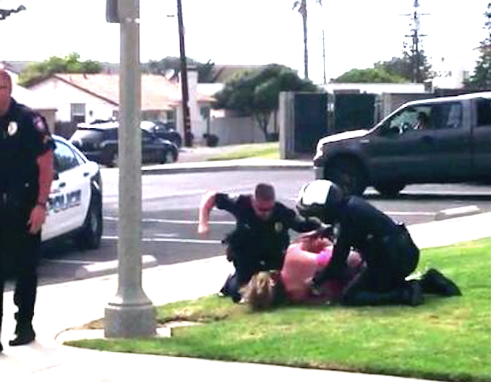 Video shows California cops punching unarmed woman in brutal arrest -- for a seatbelt violation