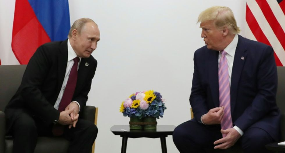 With a smile, Trump playfully tells Putin 'don't meddle in the election'