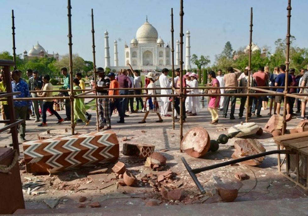 Violent winds topple stone pillars at Taj Mahal complex