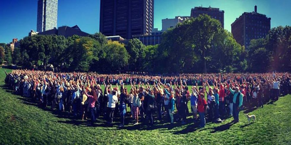2,000 people (including me) form a human peace sign for John Lennon's birthday in Central Park and try to break a world record
