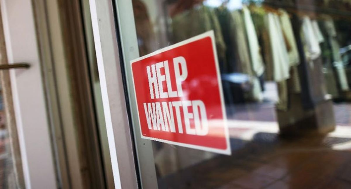 US weekly jobless claims decline again, hitting new pandemic low
