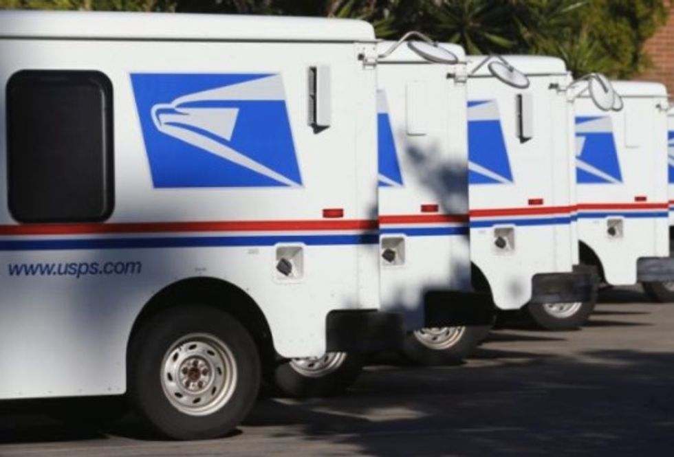 Trump orders review of US Postal Service following criticism of Amazon