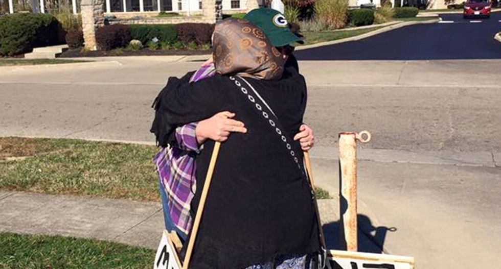 Lonely anti-Muslim protester greeted lovingly with hugs and invitation to learn about Islam -- and she does