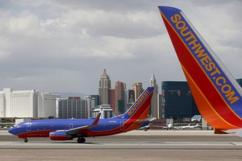 Hundreds of Southwest flights delayed by online booking problems