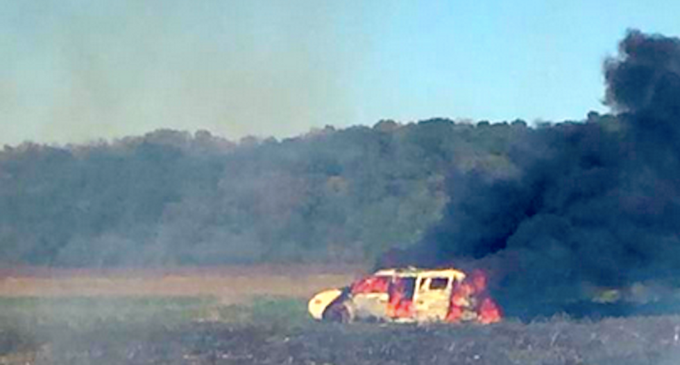 Missouri dumbass tries to put out garbage fire with van -- loaded with guns, ammo and gasoline