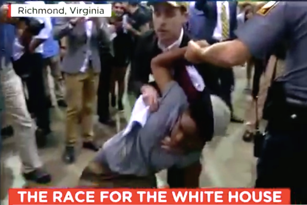 WATCH: Trump rally turns violent when supporter spits in protester's face