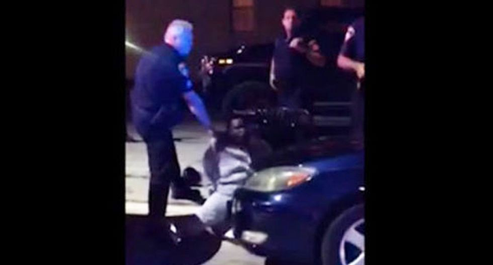 WATCH: Baltimore cop suspended for spitting in handcuffed black man's face -- then charging him with assault