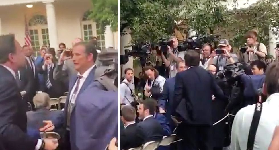 Fight breaks out with right-wing conspiracy theorists 'getting in the faces of media' after Trump presser