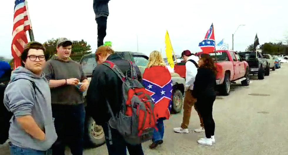 Michigan school where students taunted as 'slaves' closed as Confederate flag protest escalates to threats