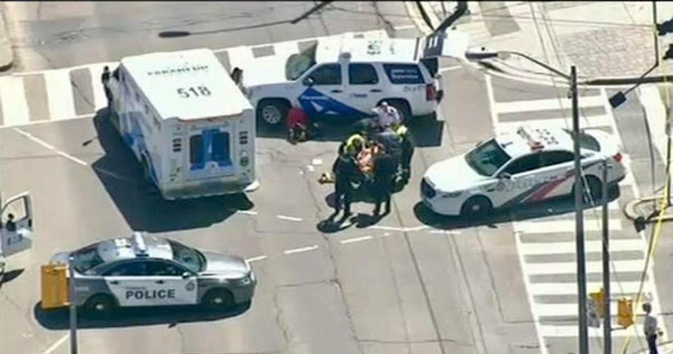 Nine dead, 16 hurt by van plowing over Toronto sidewalk: police