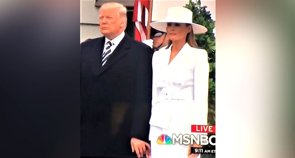 WATCH: Melania awkwardly tries to avoid letting Trump hold her hand at White House ceremony