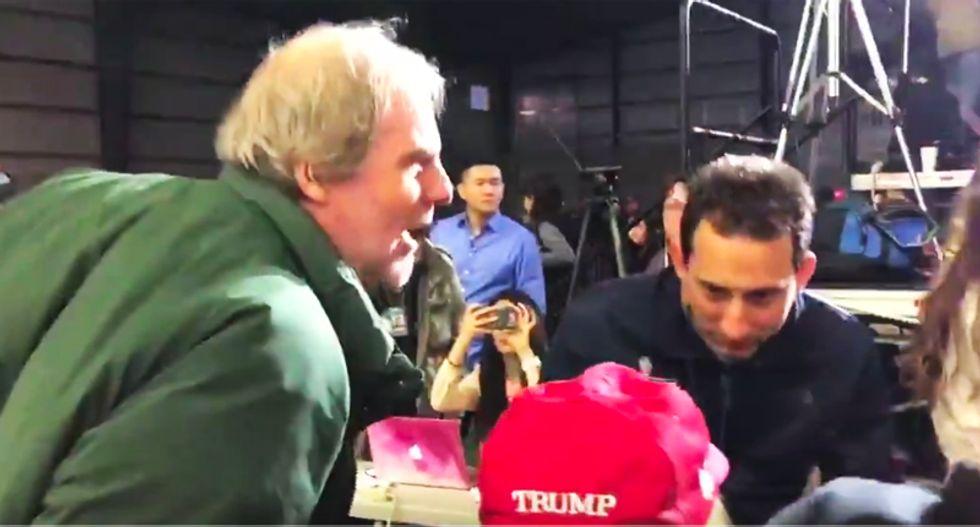 'Degenerate filth!': Screaming Trump fan raged at media following presidential rally in Michigan