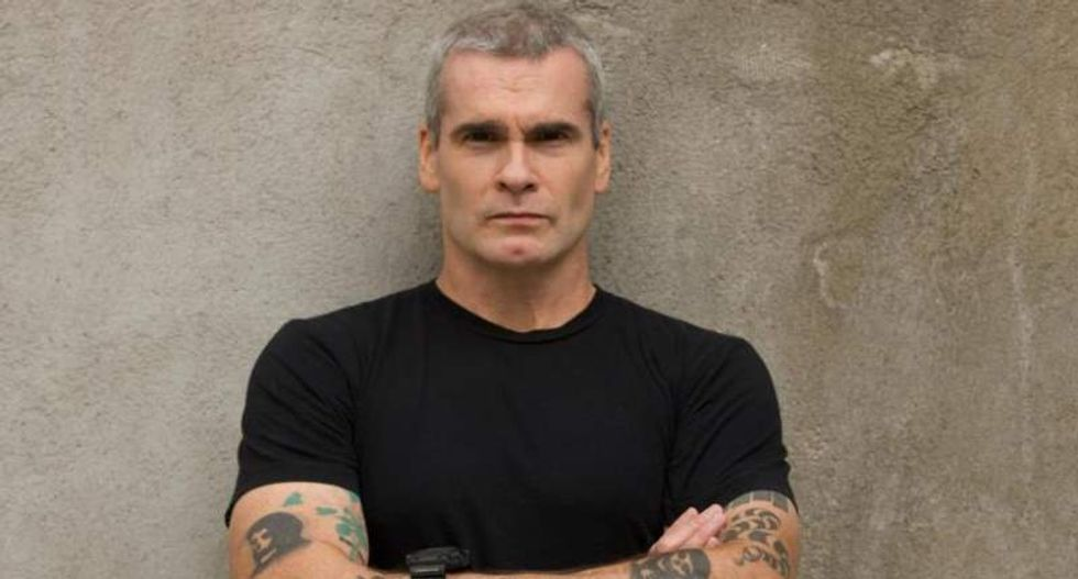 Henry Rollins rips media for featuring 'piece of sh*t' Giuliani after police shootings