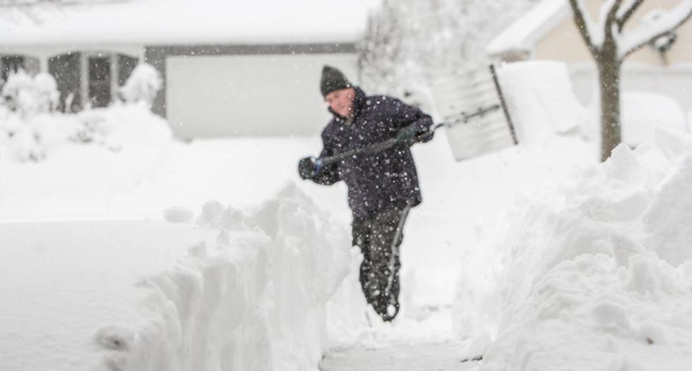 Winter storm to strike US East, snarling traffic, closing schools