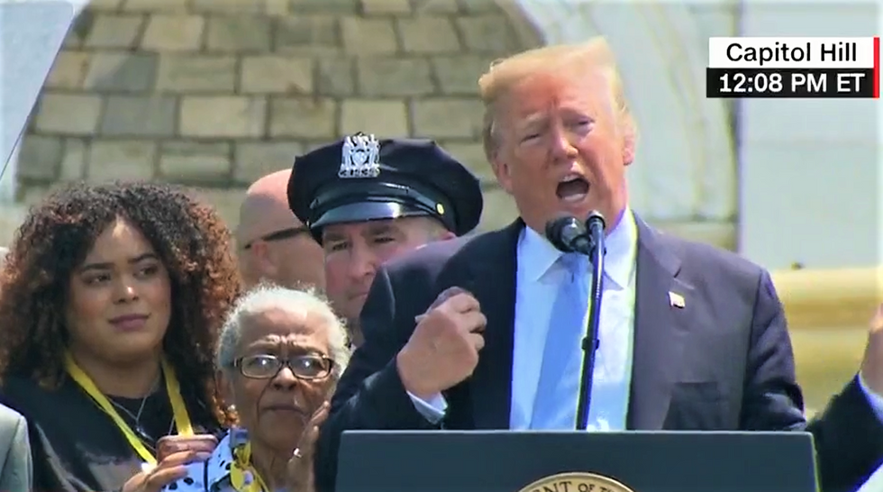 WATCH: Trump gives family of fallen officer an awkward compliment at police memorial service