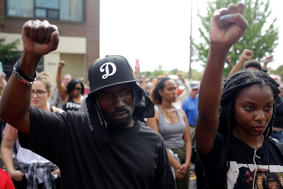 Riot police break up St. Louis protest over officer's acquittal for killing unarmed black man