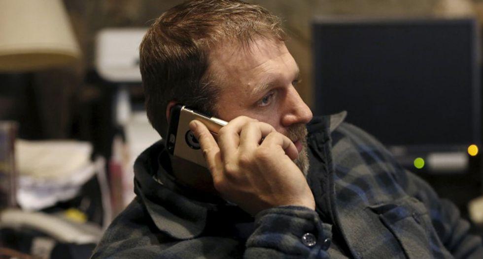 Ammon Bundy talks on the phone in an office at the Malheur National Wildlife Refuge near Burns, Oregon, January 5, 2016. (REUTERS/Jim Urquhart)