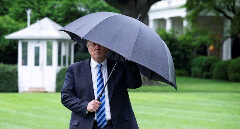 Trump launched Twitter outburst after 'substantial rain' ruined his day at his golf course