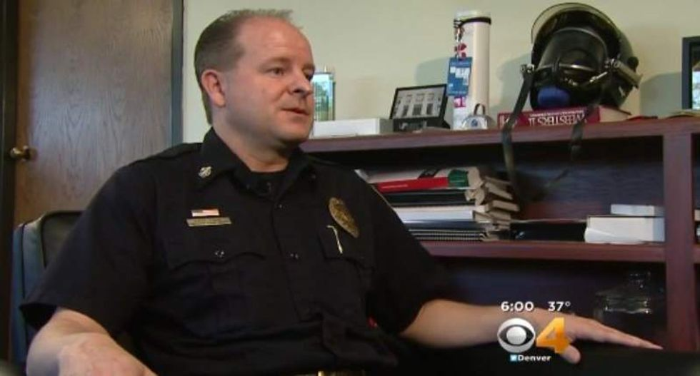 Denver fire chief stabbed by woman while sitting inside SUV