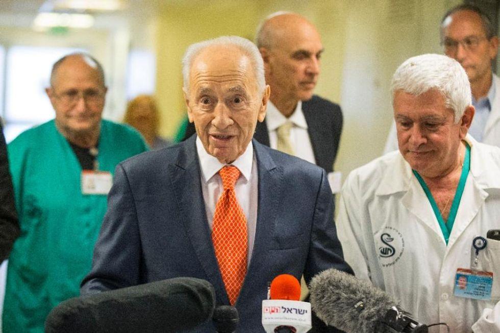Israel's Shimon Peres hospitalised for 'irregular heartbeat': office