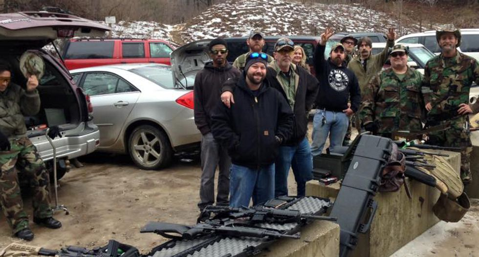 Michigan militia vows to 'take up arms' to defend Flint residents in fight with state over poisoned water
