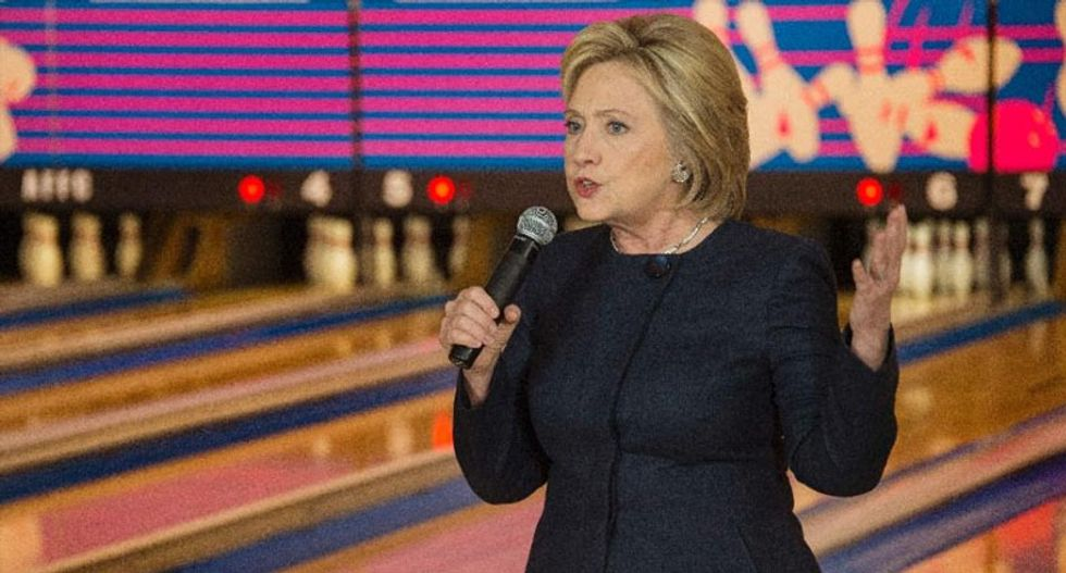 Clinton tries to bowl over Iowa as Sanders surges