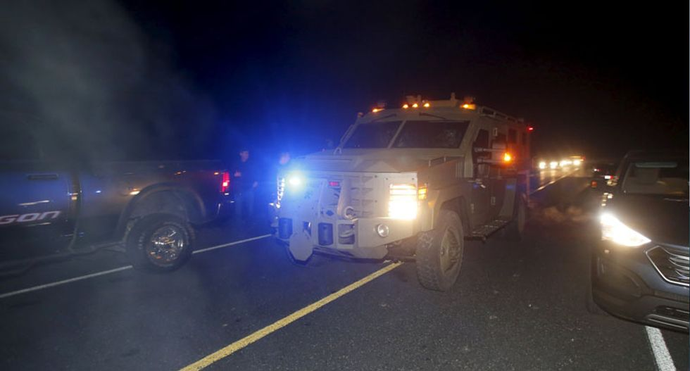 Oregon occupation simmers as handful of militants are surrounded by law enforcement