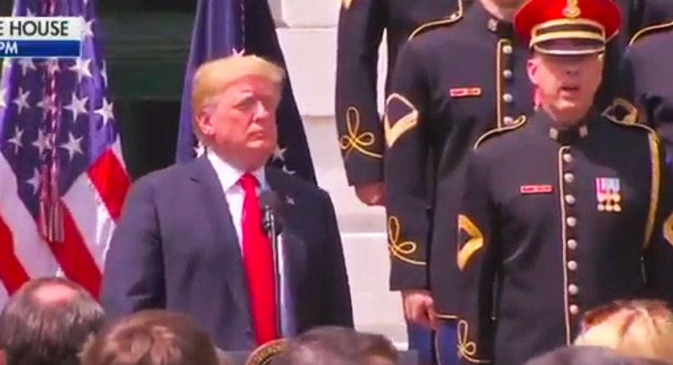 WATCH: Trump fakes his way through singing 'God Bless America' at Eagles-less White House ceremony