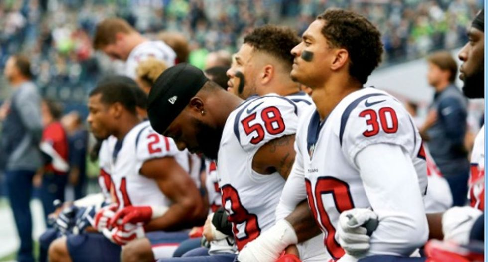 Most of NFL's Houston Texans kneel during anthem after owner's 'inmates' remark