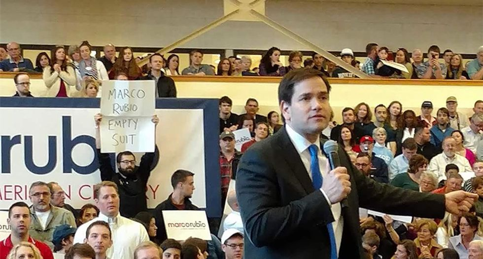 Protester at Marco Rubio's rally got roughed up for holding an 'empty suit' sign