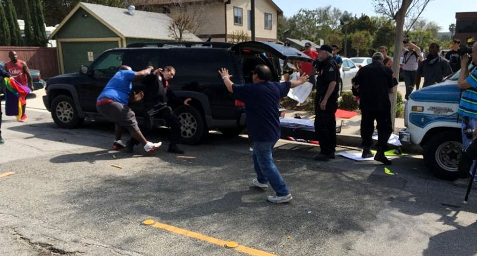 'Violence is not acceptable': Police hunt for suspect in Anaheim KKK stabbings