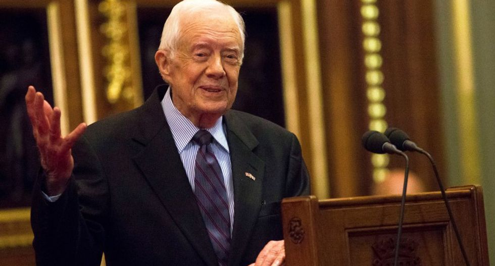 Jimmy Carter says he no longer needs cancer treatments