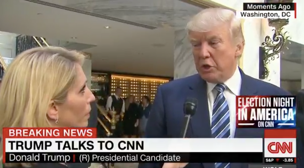 WATCH: Exhausted-looking Trump gets snippy when CNN asks if hotel opening is just 'free advertising'