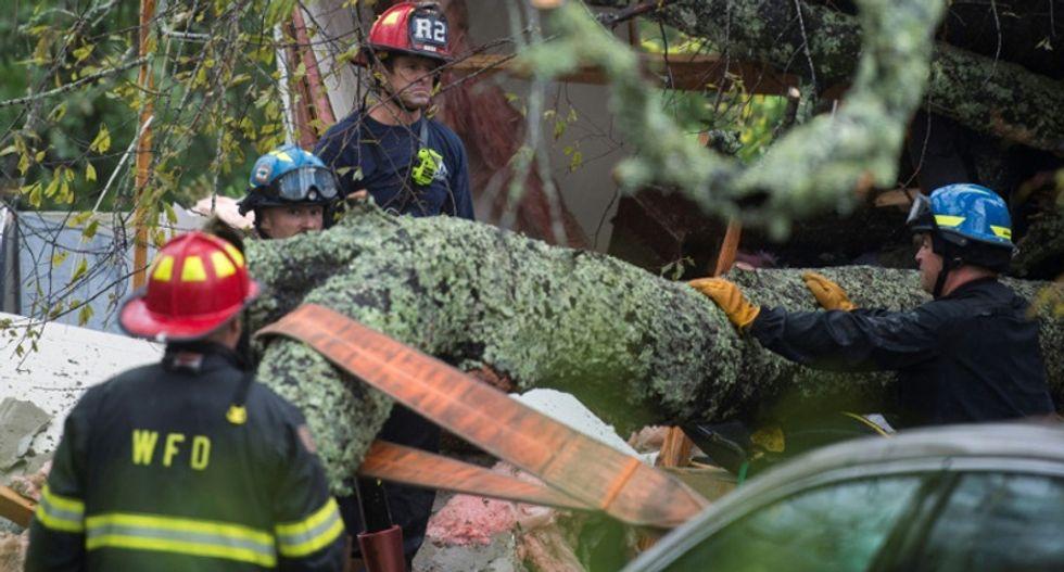 Several dead, hundreds rescued as Hurricane Florence pounds Carolinas