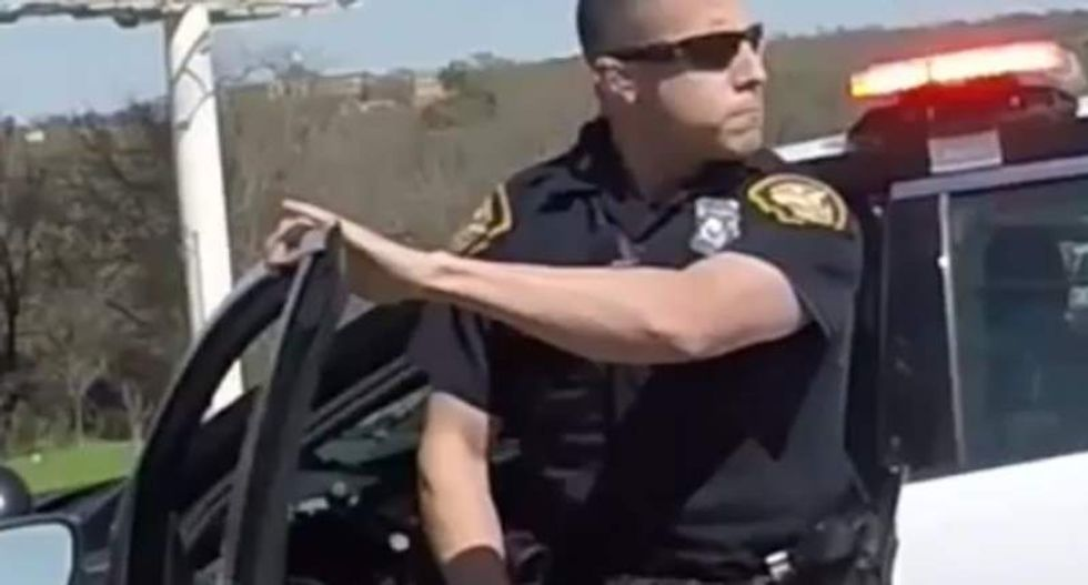 Texas cop under investigation after video shows him pepper-spraying bikers for no reason