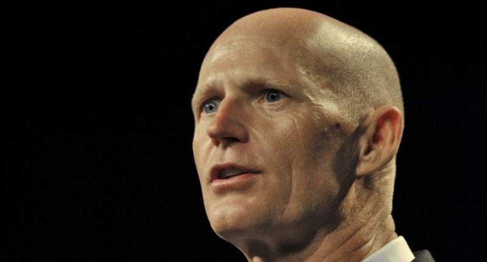 Florida Gov. Rick Scott proposes new gun sale limits after Parkland school shooting
