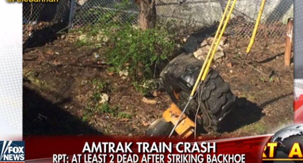 Amtrak train derails after hitting backhoe outside of Philadelphia killing two