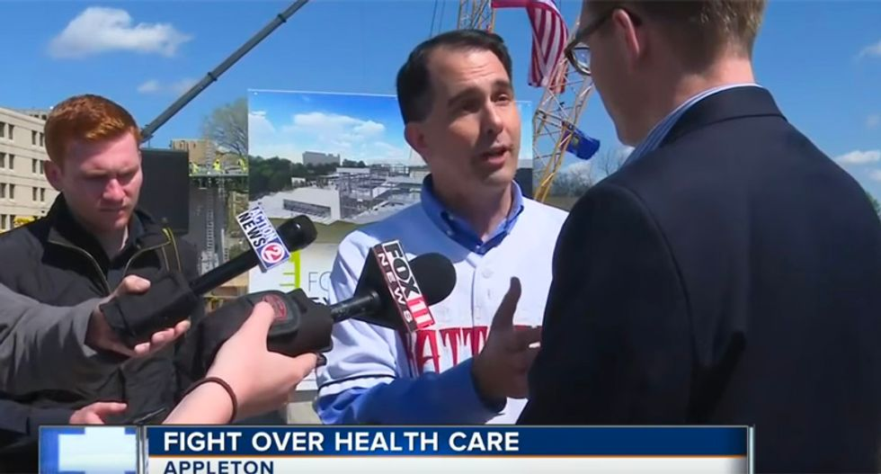 WATCH: Scott Walker blows up at county exec for asking about people losing health care instead of tourism