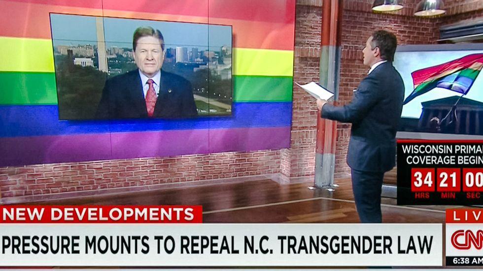 Well played: CNN trolls anti-transgender activist with massive rainbow flag backdrop