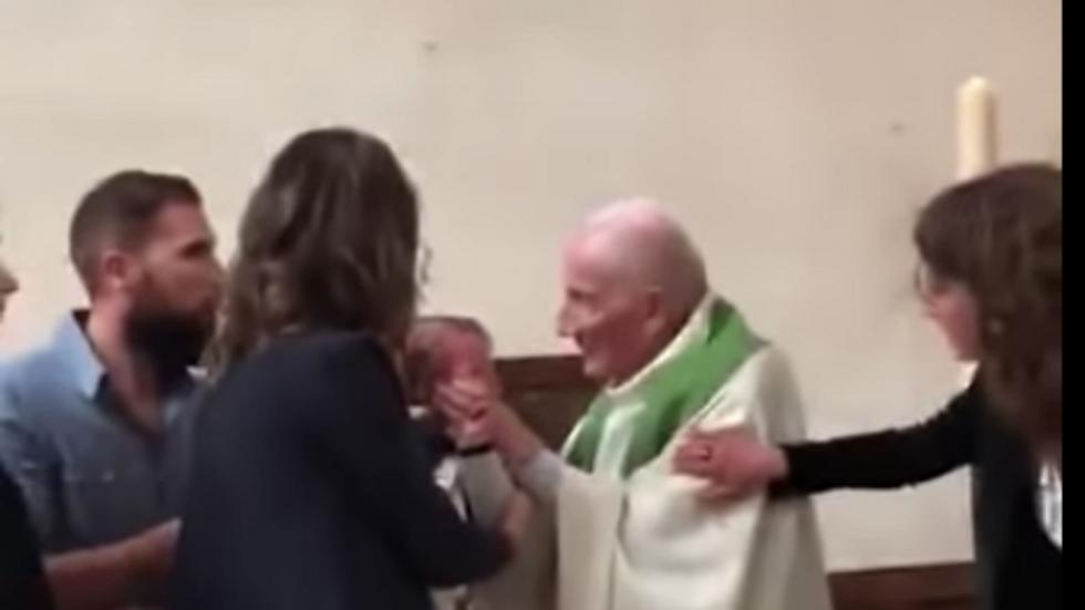 WATCH: Catholic priest slaps infant across the face before baptizing him