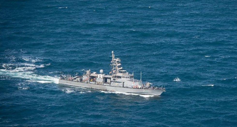 US naval ship fired warning shots at Iranian vessel: official