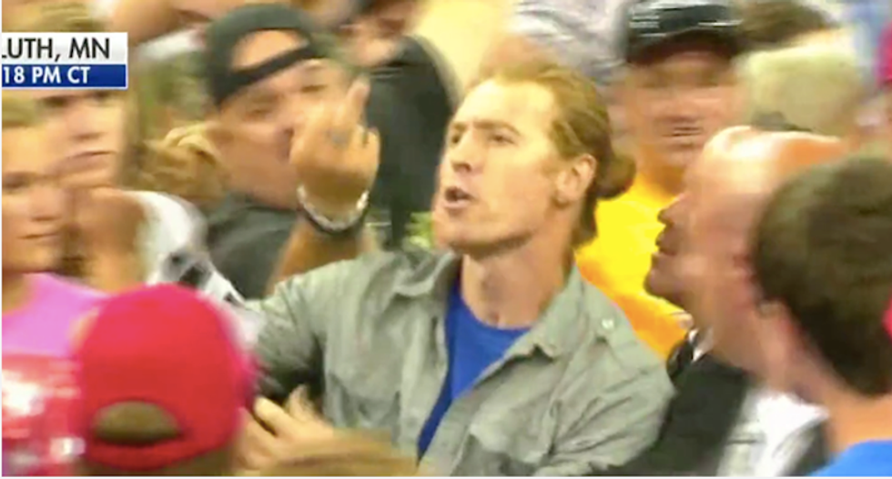 Protester targeted by Trump for his 'long hair' calls him out again for palling around with a pedophile
