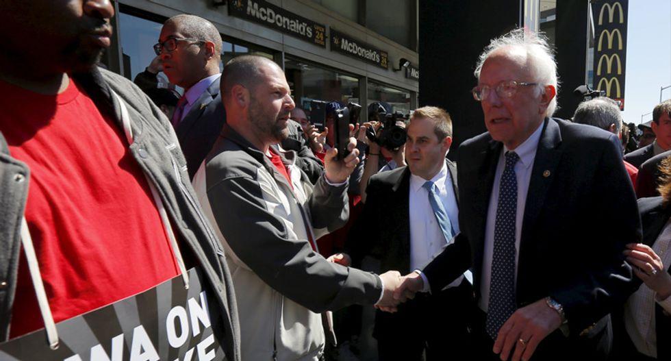 Crowd cheers as Bernie Sanders joins Verizon workers' picket line in Brooklyn