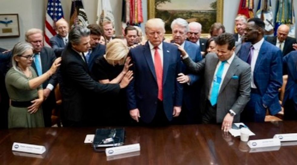 Christian leaders laid hands on and prayed for Donald Trump ahead of impeachment vote