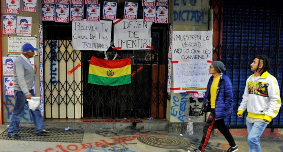 Protesters seize state-run TV in Bolivia as tensions soar
