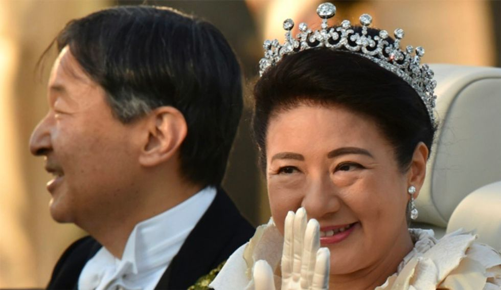 Cheering crowds greet Japan's new emperor in rare parade
