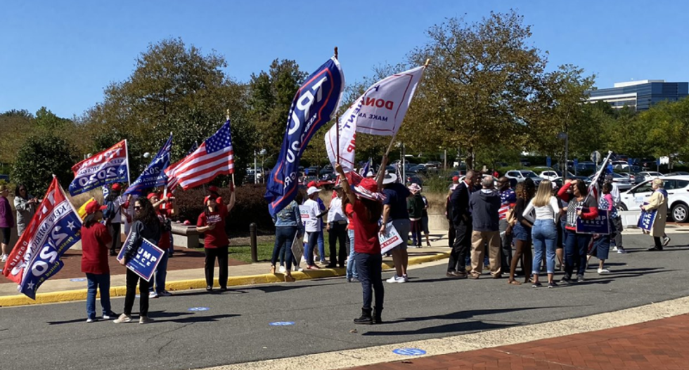 WATCH: Trump supporters descend on early voters in Virginia — and try to obstruct polling site
