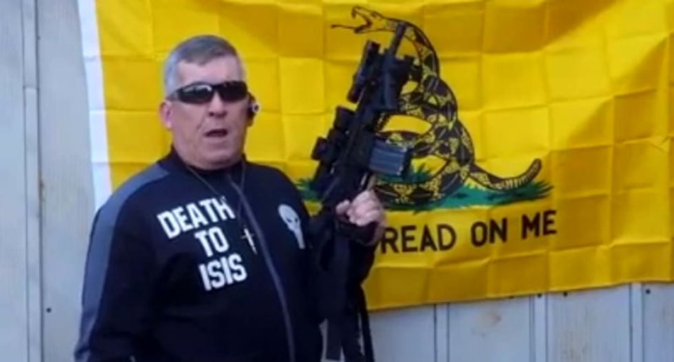 Right-wing militant to shred Quran and pictures of Hillary at rifle-toting Georgia capitol rally