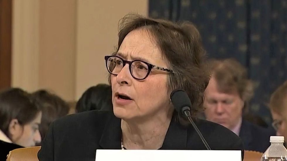 'I'm insulted!' Scholar rains hell on Republican who questioned her integrity at impeachment hearing